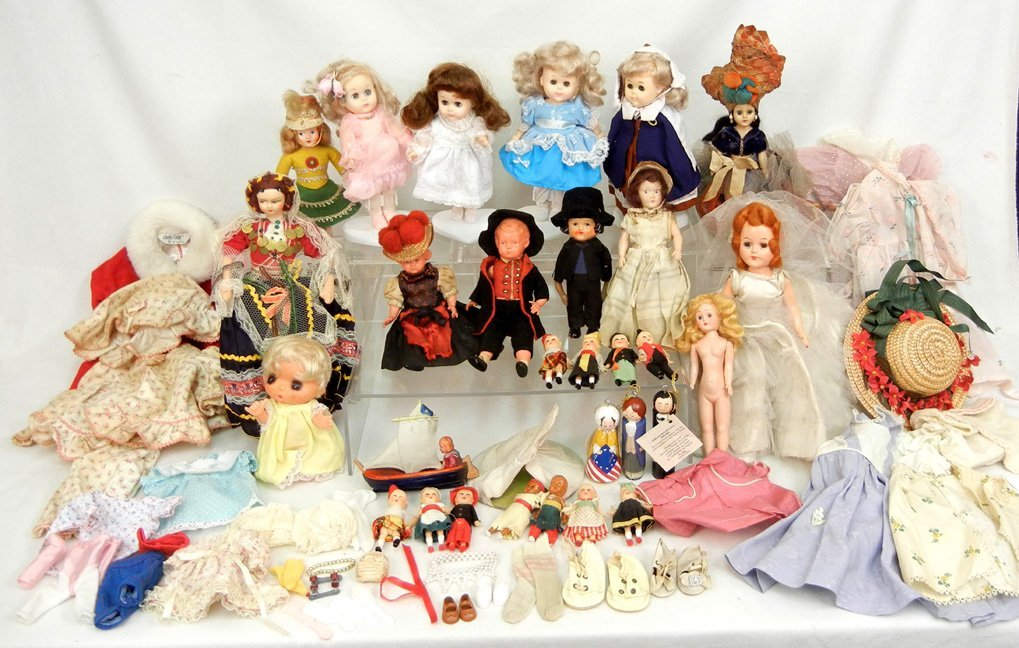 Large grouping of dolls and clothes,