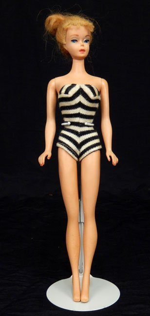 1958 Barbie doll wearing black and white swimsuit
