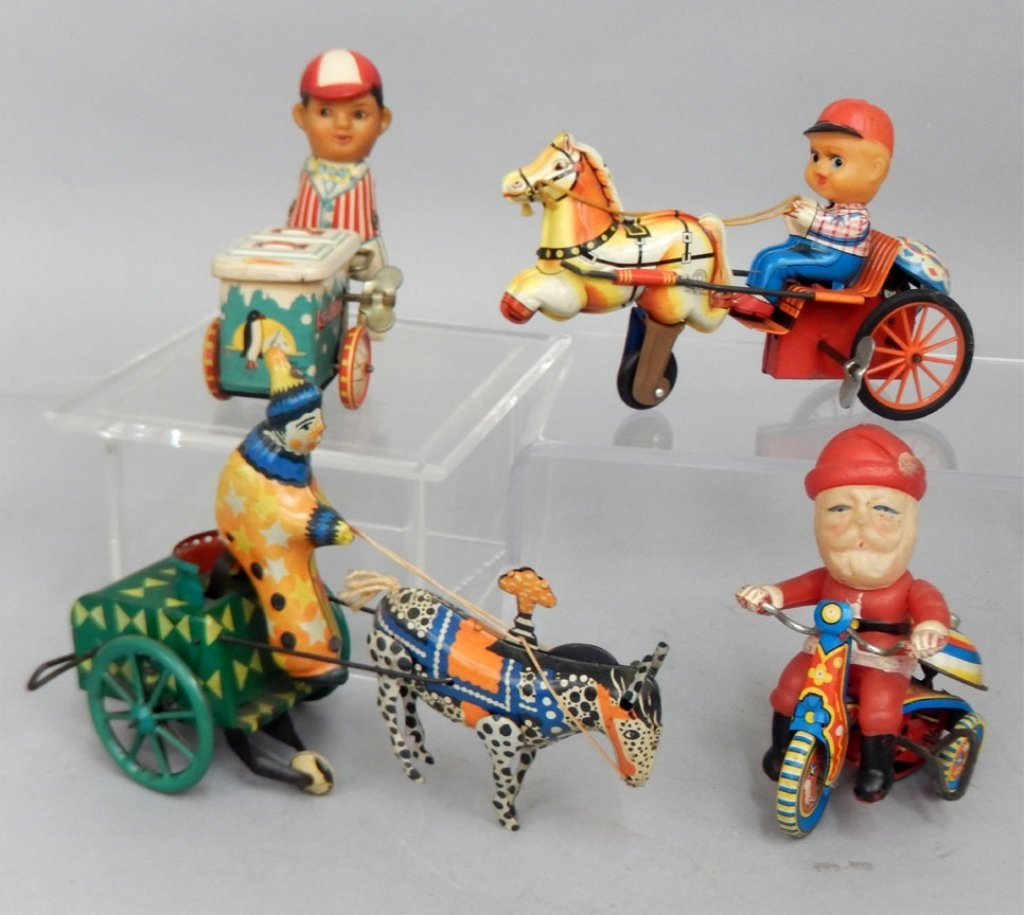 Four tin litho windup toys