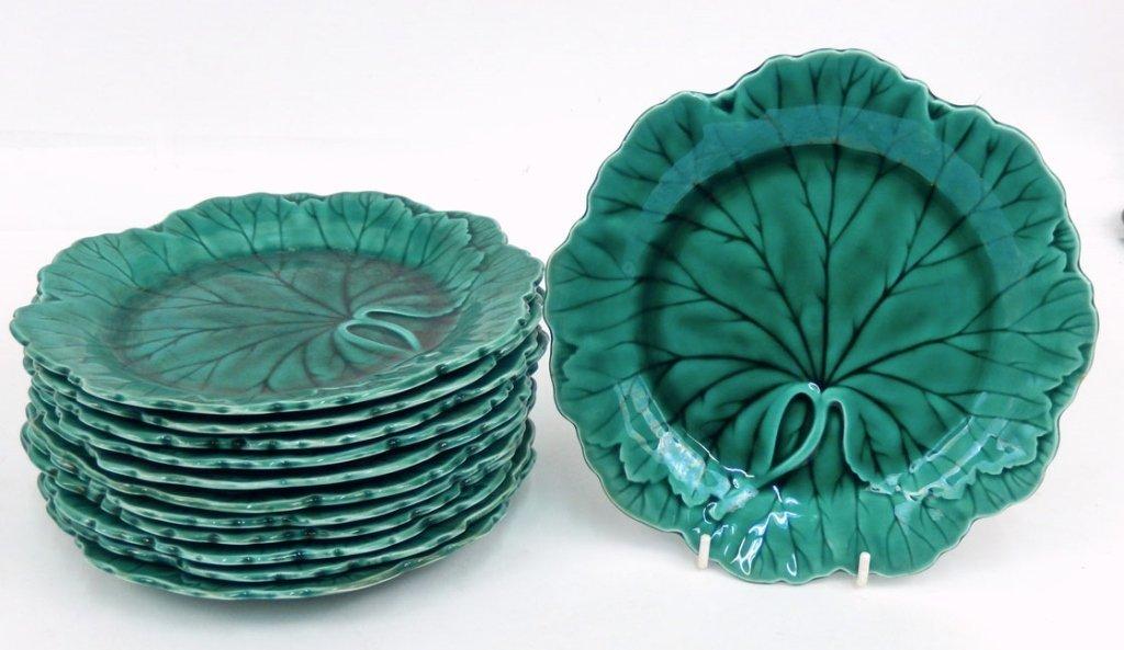 Twelve Wedgwood Majolica green leaf plates