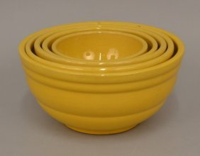 Set Of Five Graduated Yellow Ware Mixing Bowls
