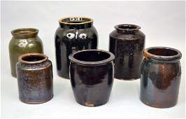 Grouping of stoneware crocks jars and a redware