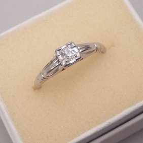 18k White Gold And Diamond Ring With A 9 Pt Solitaire,