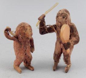 Two Early Windup Monkeys
