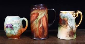 Three American Belleek hand painted porcelain tankards