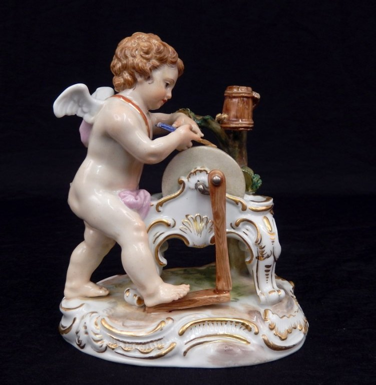 Meissen porcelain figurine of cupid sharpening his