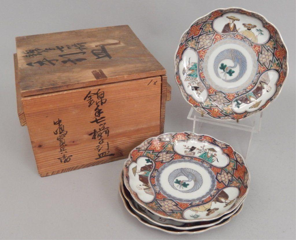 Set of four Japanese Imari plates in original shipping