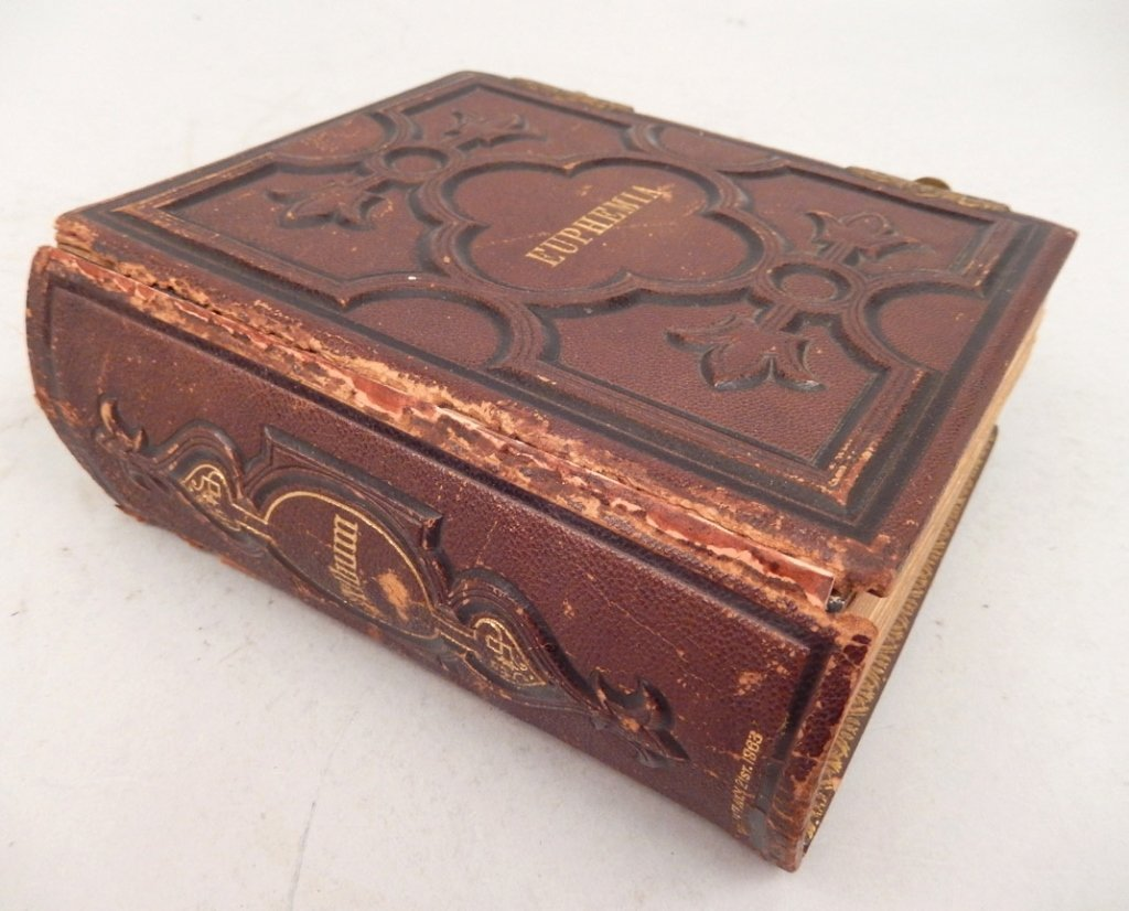 Gilt embossed leather Victorian photograph album with
