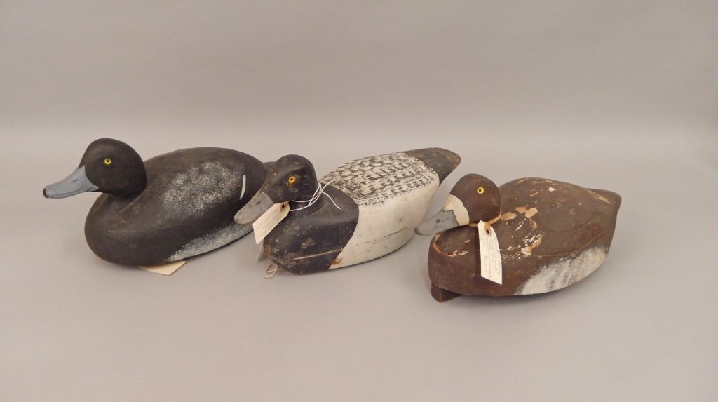 Three wooden duck decoys