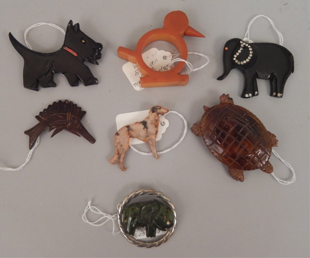Grouping of bakelite animal pins and napkin ring