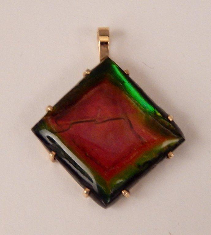 Ammolite gemstone in 14k gold bezel