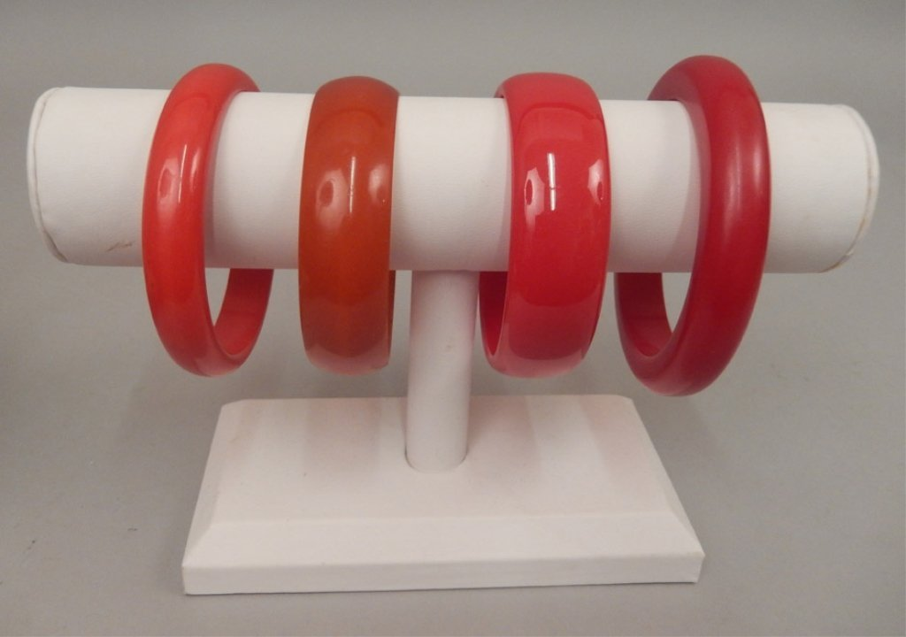 Four red bakelite bangles