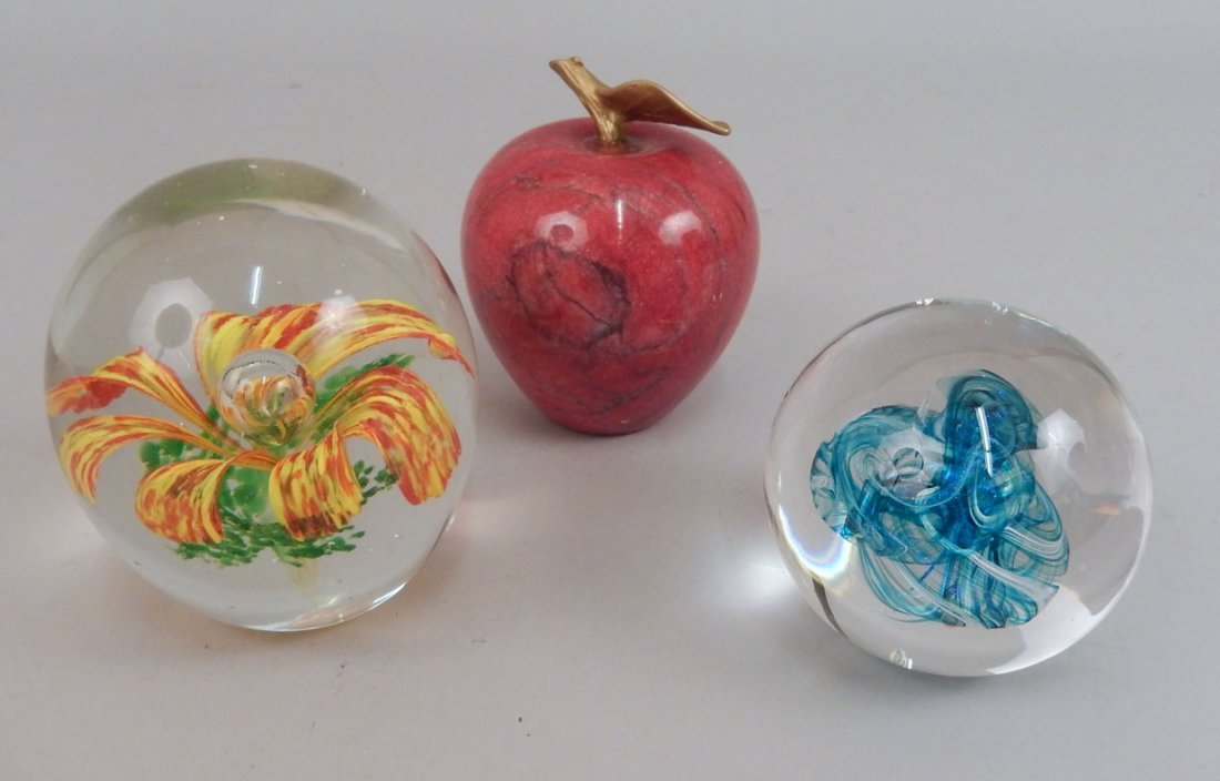 Three paperweights