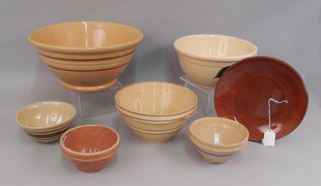 Grouping of yellowware and redware pottery pieces