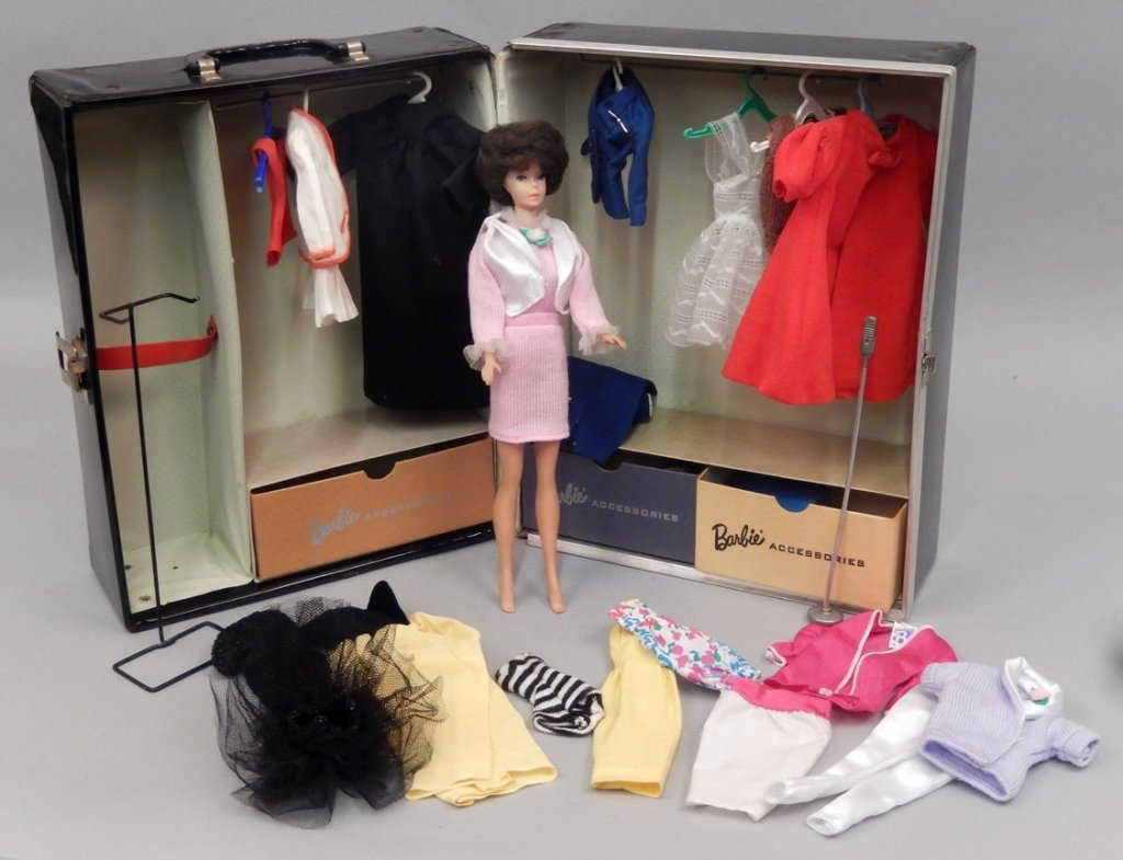 Bubble cut Barbie with tagged Barbie clothes and