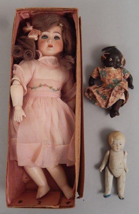 Franz Schmidt bisque head doll, two bisque dolls