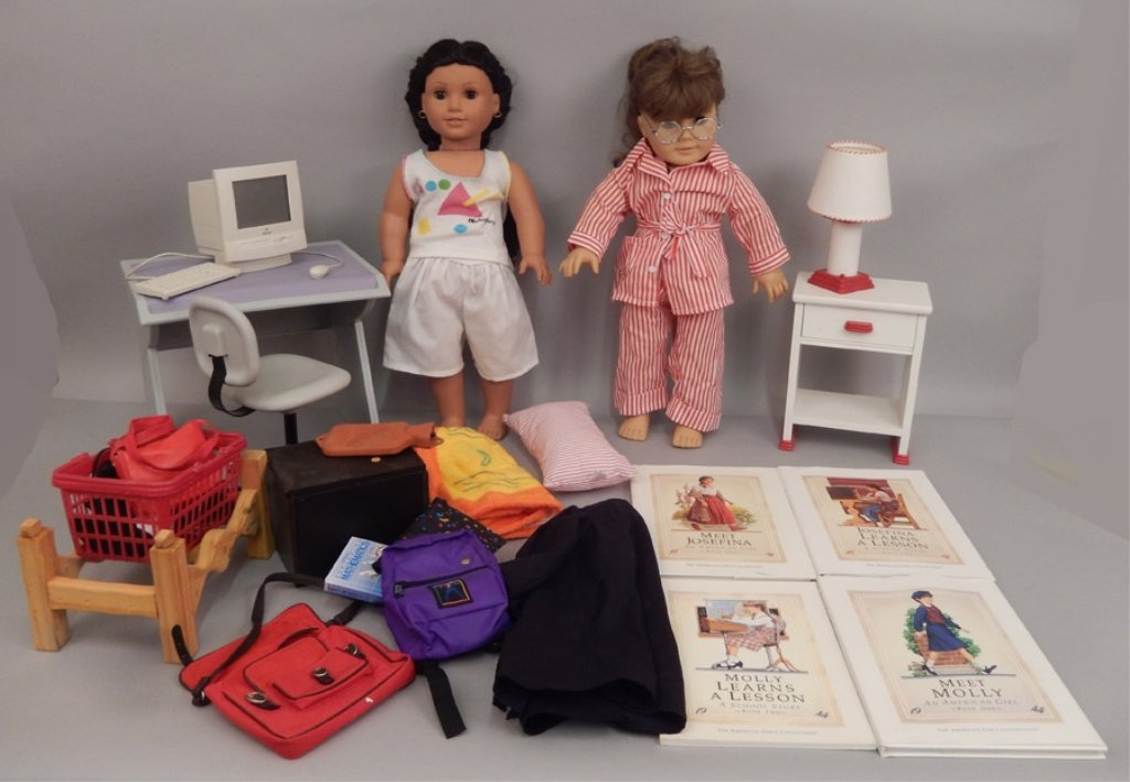Two American Girl dolls with accessories and books
