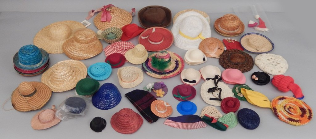 Grouping of doll hats