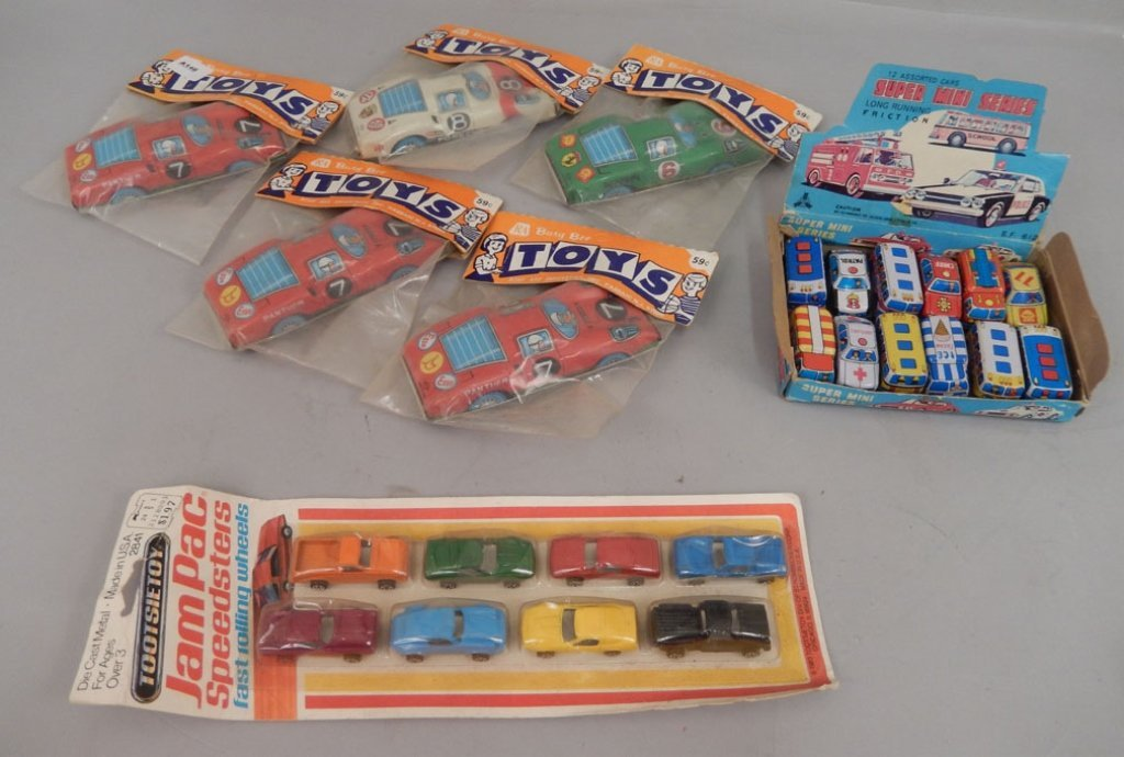 Collection of tin toy cars in packages