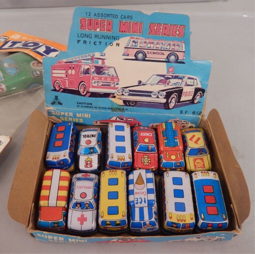 Collection of tin toy cars in packages - 2