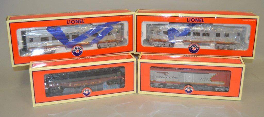 Four Lionel Railroad cars