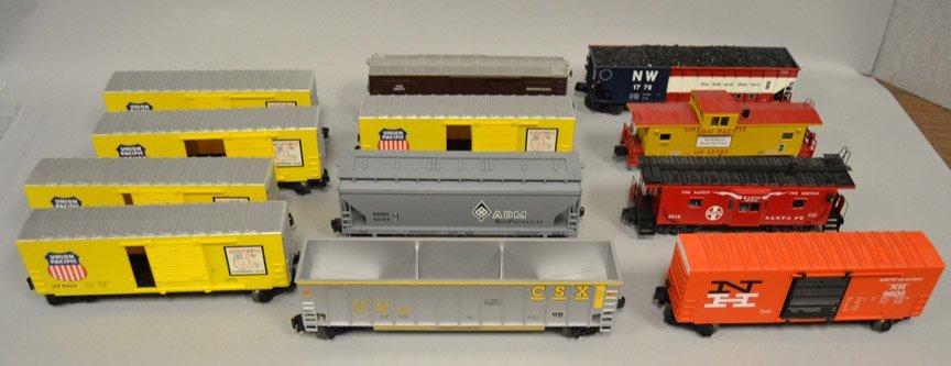 Twelve O gauge Railroad cars