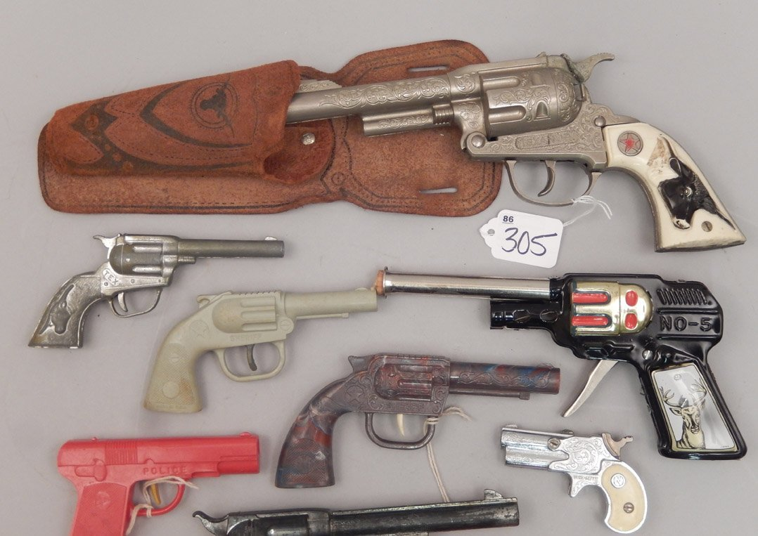 Grouping of toy cap guns - 2