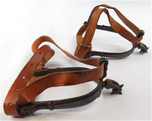 A PAIR OF SPANISH COLONIAL SPURS