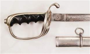 A. U.S. M1902 OFFICER'S SABER AND A CADET SWORD