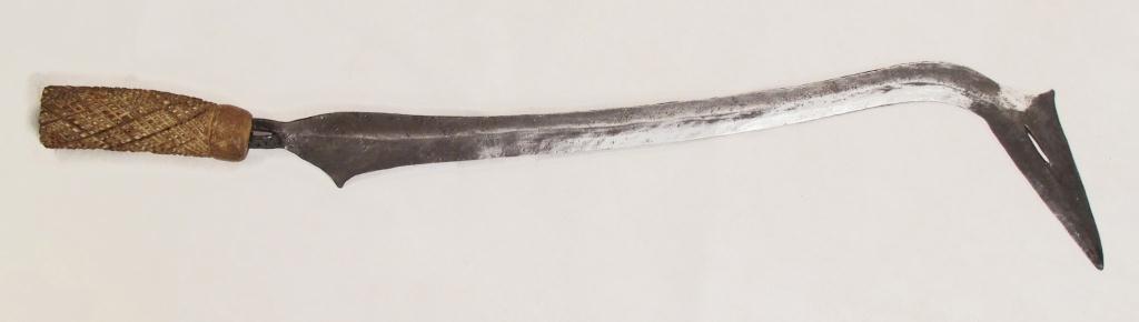 A YAKOMA SICKLE SWORD AND A UGANDAN TRIBAL DRUM