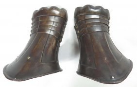 A Pair Of Black & White Armor Gauntlets