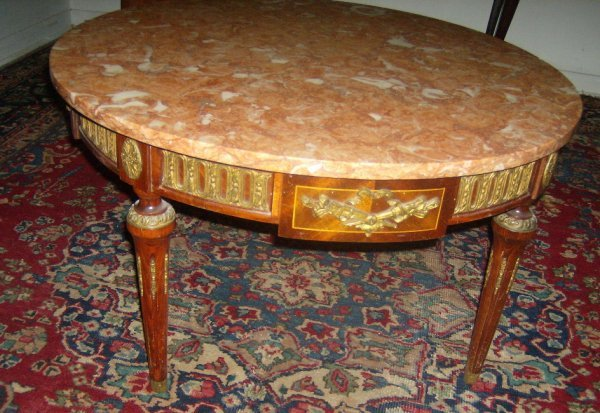 3: Round marble top coffee table