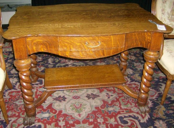 8: Carved quarter sawn oak library table
