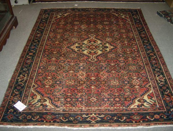 11: 4'6 x 6'4 hand made Oriental carpet