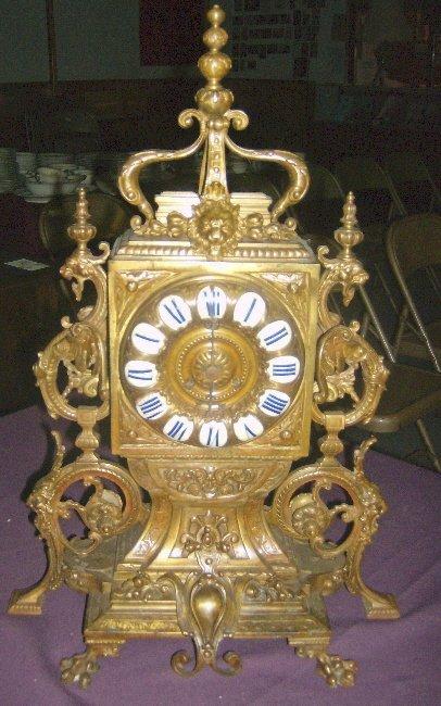 20: Victorian bronze clock, porcelain dial