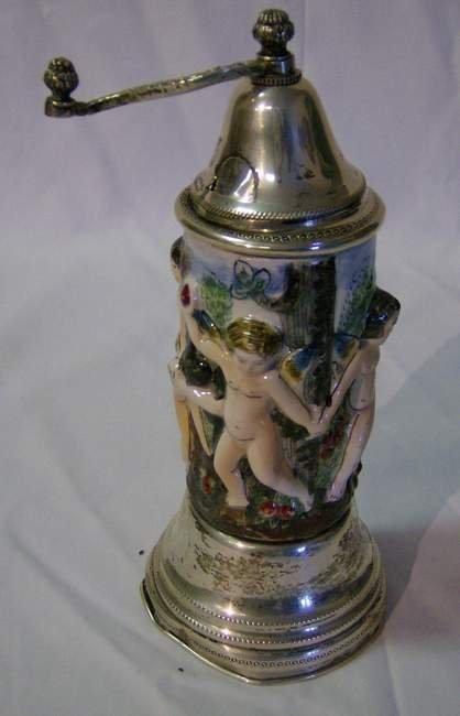 318: Silver mounted Capodimonte silver music box