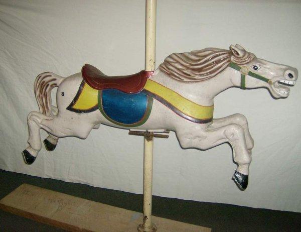 18: Iron carousel  horse on wooden base