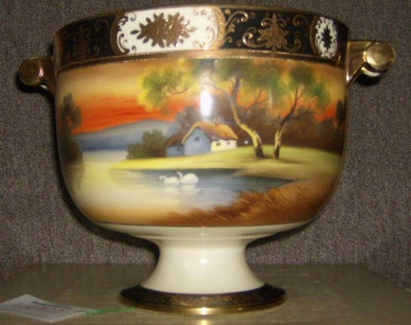 22: Japanese hand painted handled footed bowl with lust