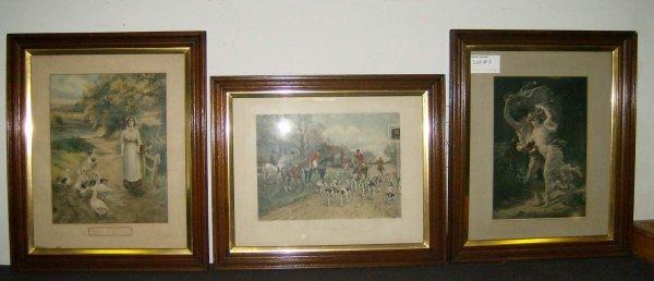 6: Three deep walnut frames with prints