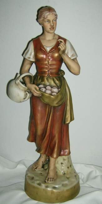 "309: Royal Dux statue of Woman with apples, 20 1/2""h"