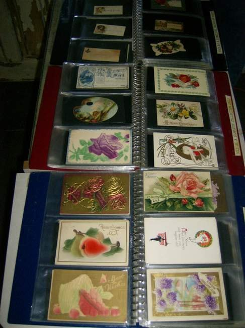 17: Three binders of Postcards, Calling cards, trading