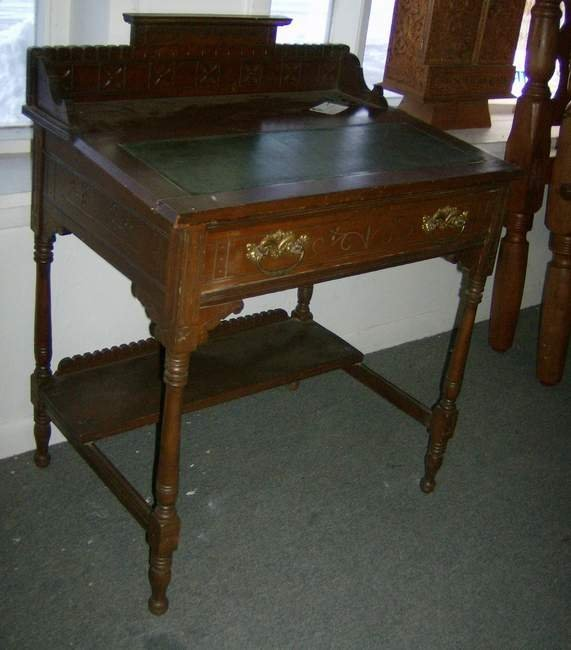 305: Victorian spool carved one drawer desk with galler