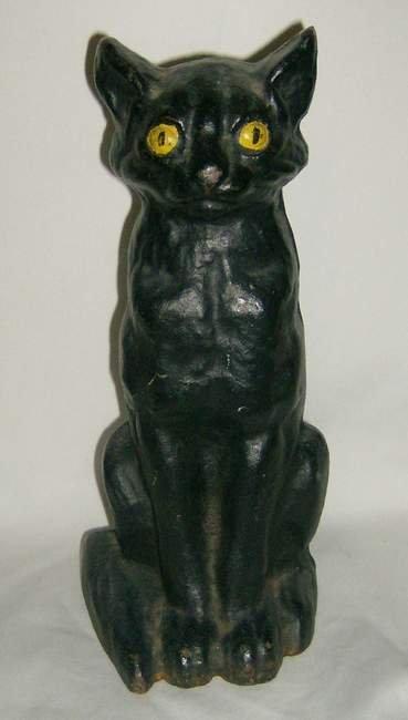 312: Black Cat cast iron doorstop