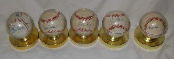 12: Five New York Yankees autographed baseballs