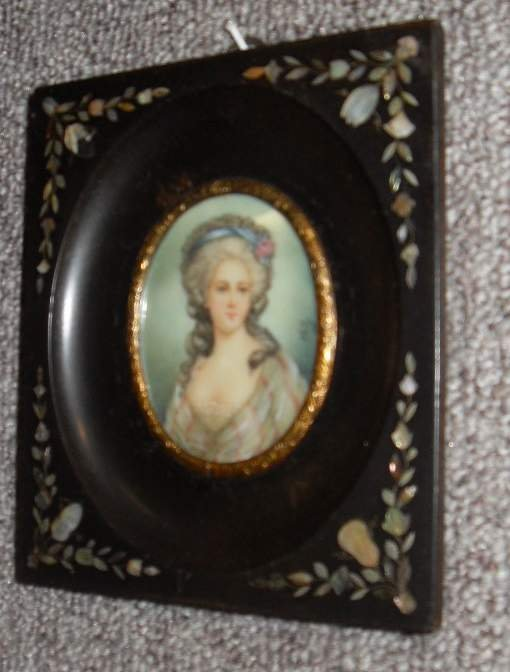 15: Painting on ivory of a lady in mother of pearl deco
