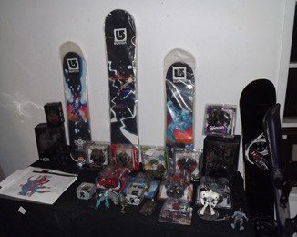 7: Lot of Action figures, snow boards, lithographs