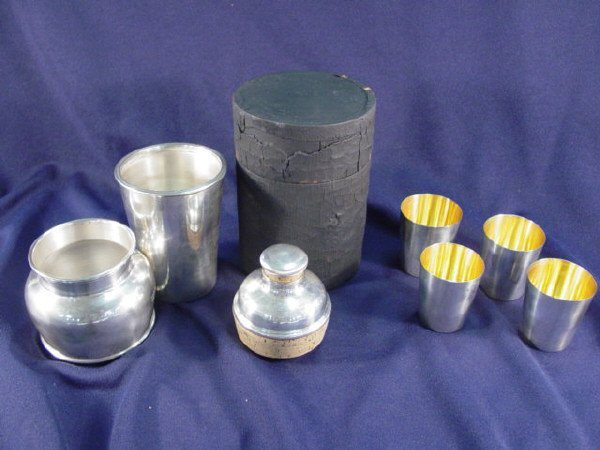 87: International Sterling four cups and shaker with