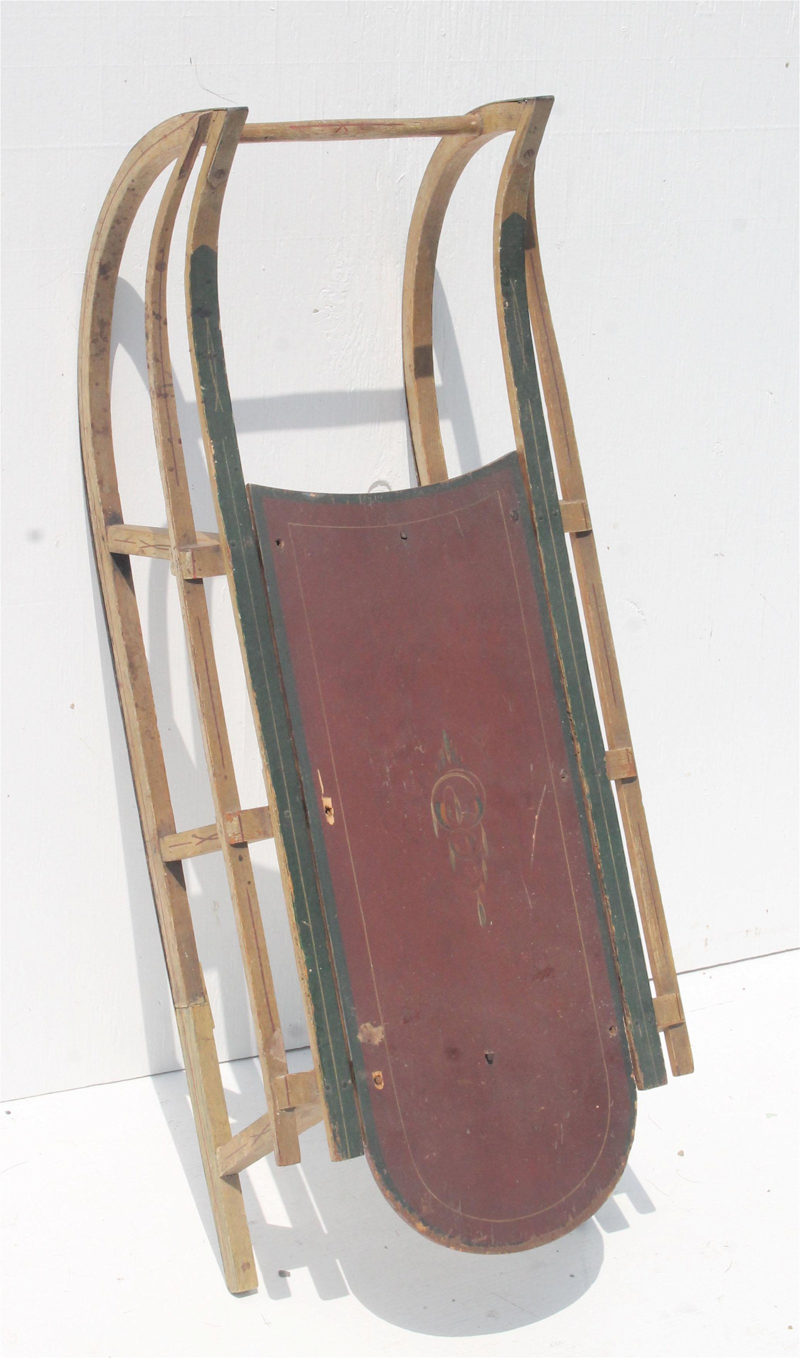 antique child's sleigh with hand painted decoration -