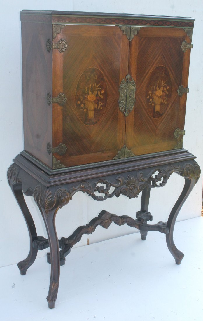 Victorian carved walnut and inlaid two door cabinet on