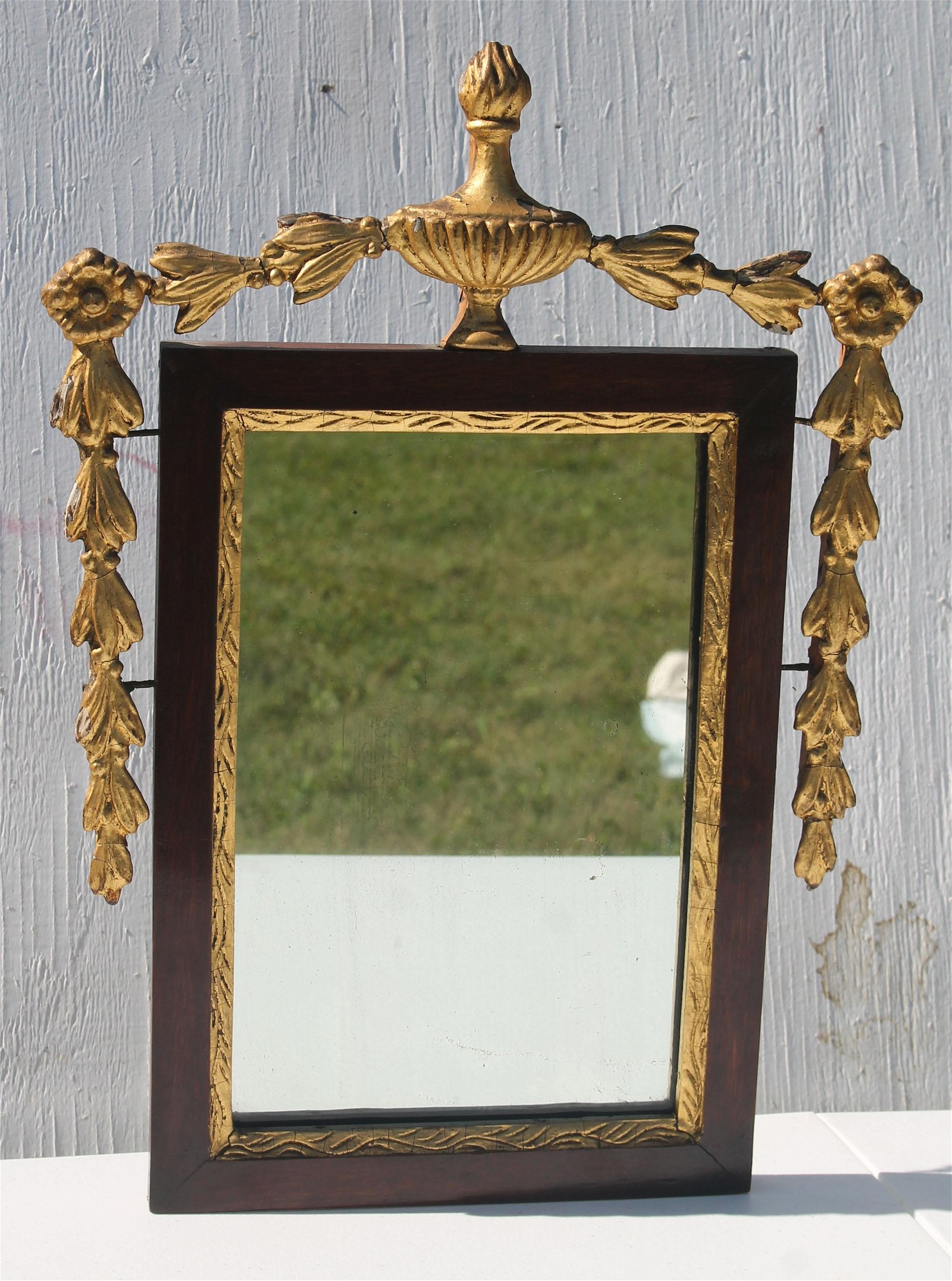 antique courting mirror with gold gilt urn, floral, and